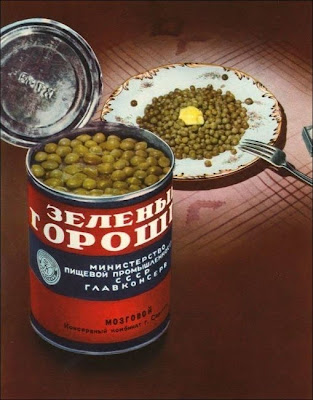 An open can of peas and a bowl of peas