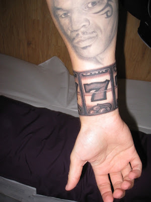 face tattoos, mens tattoos, number tattoos, forehand tattoos, wrist tattoos
