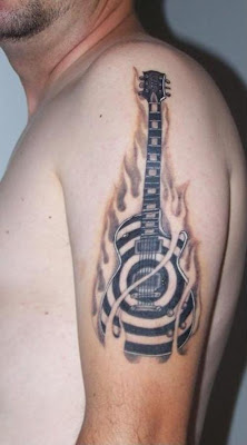 flame tattoos, guitar tattoo, shoulder tattoos, men tattoo,