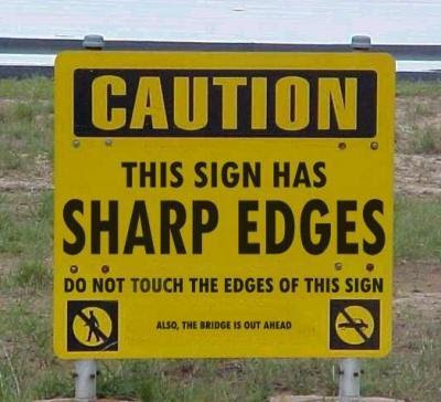 caution this sign has sharp edges