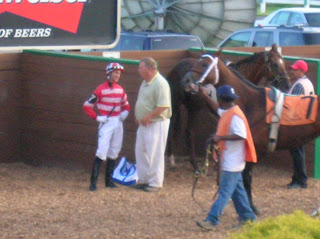 Jockey Scott Spieth receives his instructions before riding Deputy Glitters at Mountaineer Memorial Day 2007