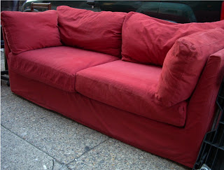 Uhuru Furniture & Collectibles Red Ikea Couch SOLD