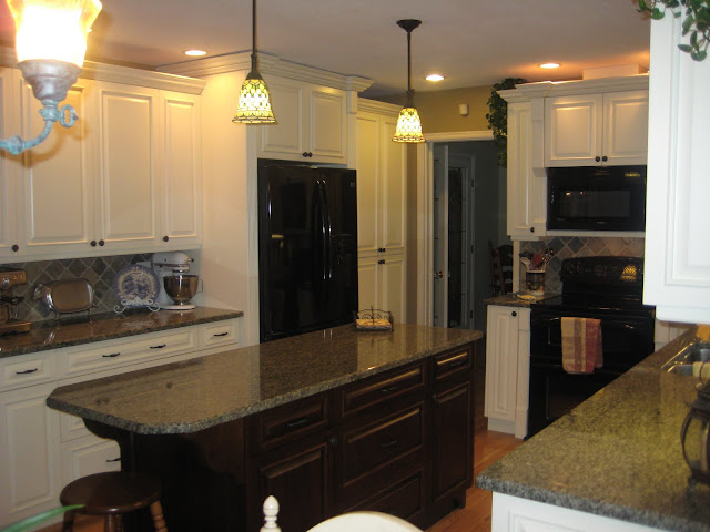 contrast between the white (actually cream) cabinets and dark island