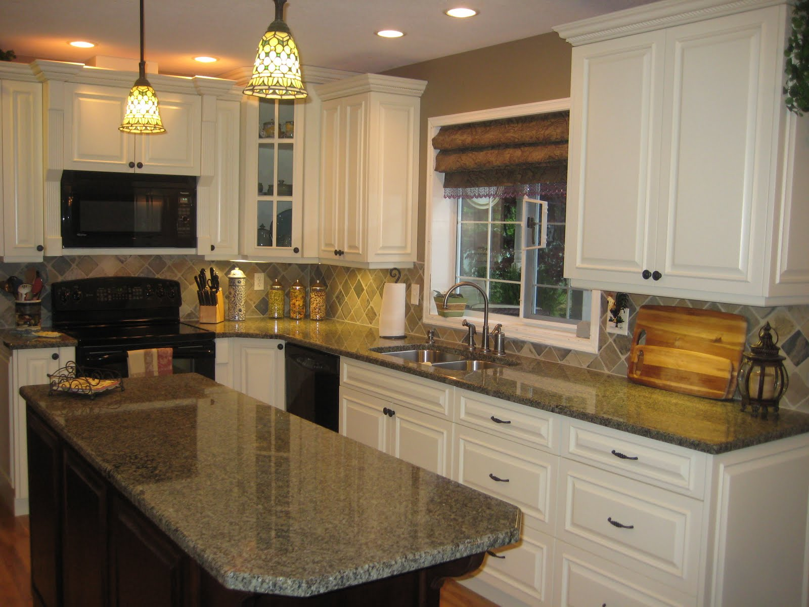 Cream kitchen dark island for Cream kitchen paint ideas