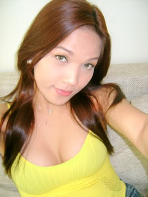 pretty unknown filipina in her breast hugging yellow shirt