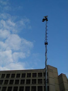 FBI building with tv pole