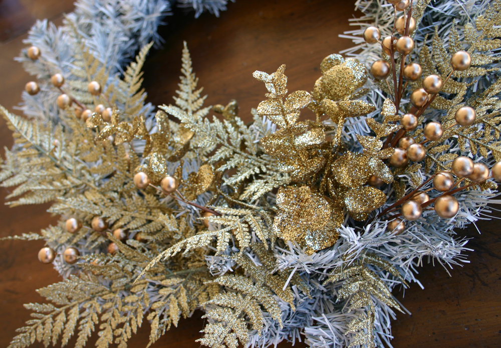 Sparkle power spray painted holiday wreath diy tutorial oh a pair of wire cutters comes in handy here so that you can cut your fake flowers down arrange them however youd like mightylinksfo