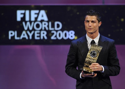 Portuguese football player Cristiano Ronaldo poses with FIFA world footballer of the year 2008 award during a ceremony on January 12, 2009 in Zurich. Ronaldo, who is also holder of the prestigious Ballon d'Or for the European Footballer of the Year, beat off competition from 2007 winner Kaka (Brazil), Lionel Messi (Argentina), Fernando Torres (Spain) and Xavi (Spain).