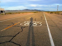 A picture of a road with a Route66 Interstate sign painted on it.
