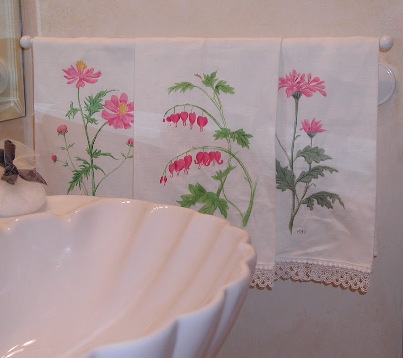 Hand painted hand towels and wastebasket. title=