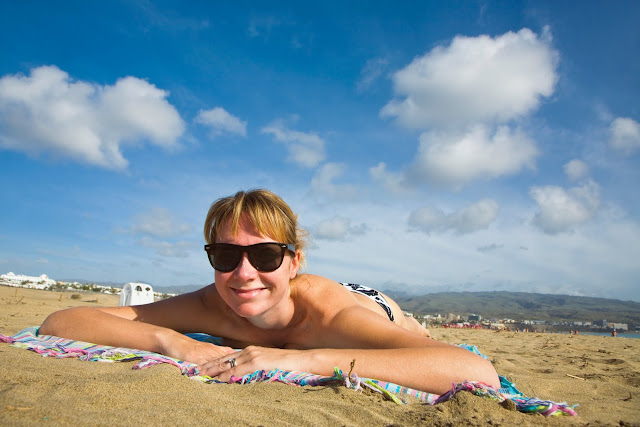 smiling woman on Maspalomas nudist beach in Gran Canaria