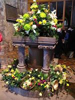 Easter floral arrangement in font of St Stephen's, Kirkby Stephen