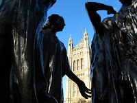Houses of Parliment through Burghers of Calais statue