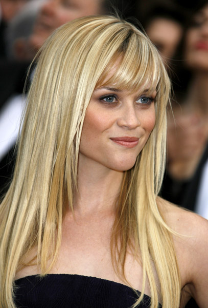 long blonde hair with full fringe. full fringe hairstyle. long
