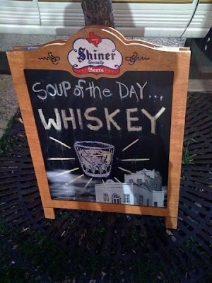 it's a sign that says 'whiskey'