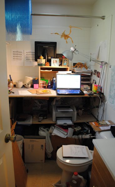 and below is my new office in my new studio i wanted slots for all my larger blank panels underneath as well as my printers paper and boxes for bathroom office
