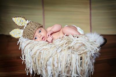 Cute baby wearing the cat cap