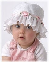 girl baby wearing white cap pics