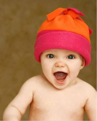 Lovely baby laughing free photo