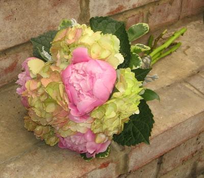 Tiny seashells accent this vibrant bouquet Sage green hydrangea medium
