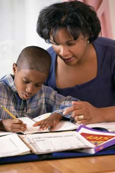 parent helping child with homework
