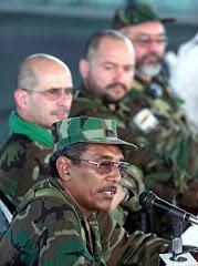 Joaquín Gómez, Simón Trinidad y Carlos Antonio Lozada, al lado del inolvidable Raúl Reyes