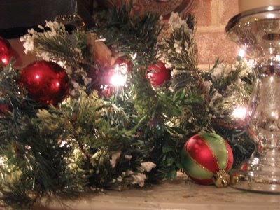 simple lighted garland with extra ornaments left over from the tree