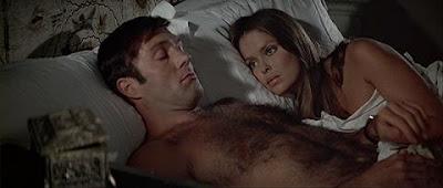 She's the spy...he's the beefcake..it's a wacky switcharoo!!