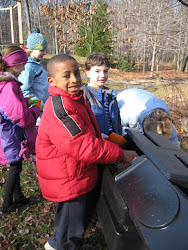 3E checks on the composter to see what's happening inside.