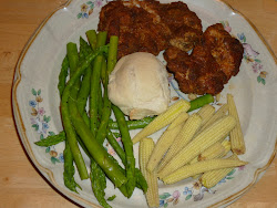 Crumb-Coated Chicken Thighs served with asparagus and baby corn