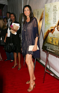Famke Janssen in a See-Thru Dress