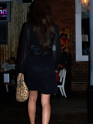 Black dress by Vivienne Tam paired with YazBerry Polka Dot Clutch