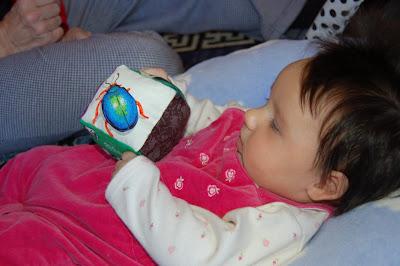 Baby Maya of Jamaica Plains, Massachusetts, enjoys giving her block a good clutch.