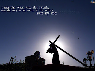 I am the way, and the truth and the life, no one comes to the father, but by me Jesus carrying cross with blue background sky photo