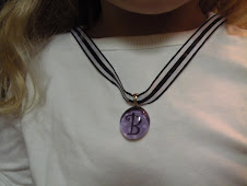 Purple polka dot chick charm with ribbon necklace $9