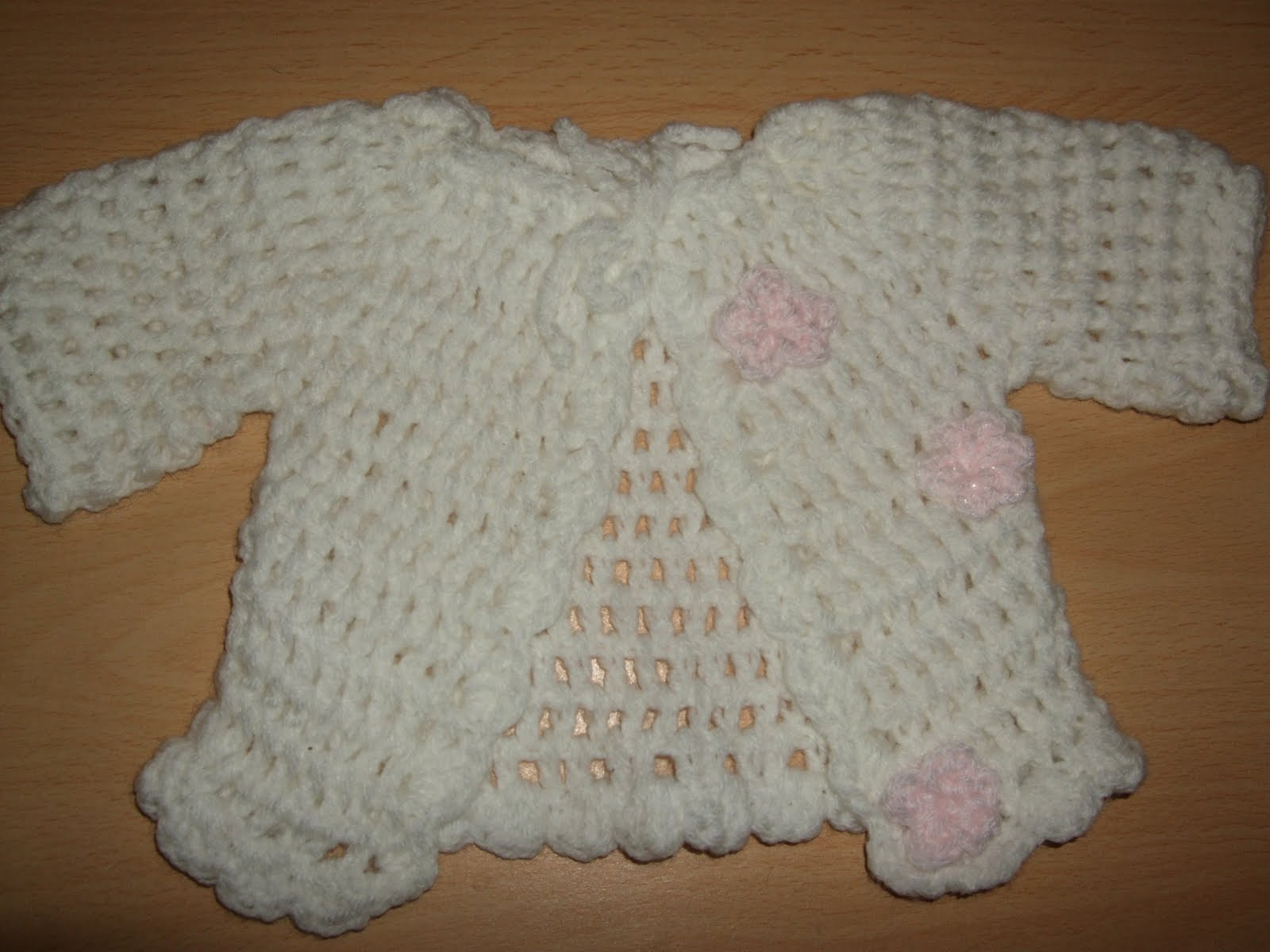 Crocheted baby clothing crochet club