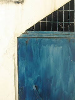 trapezoidal door painted blue