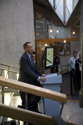 Jonathan Bland speaking at the Scottish Parliament building
