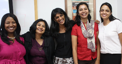 Five smiling women