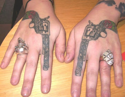 This is a best gun tattoos design on hands and i think that is very cool and