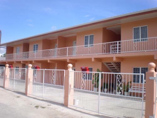 Syntegral consulting ltd trinidad and tobago real estate for 2 story 2 bedroom apartment plans