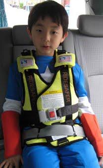 Ride Safer Travel Vest Using Tether Lap Belt