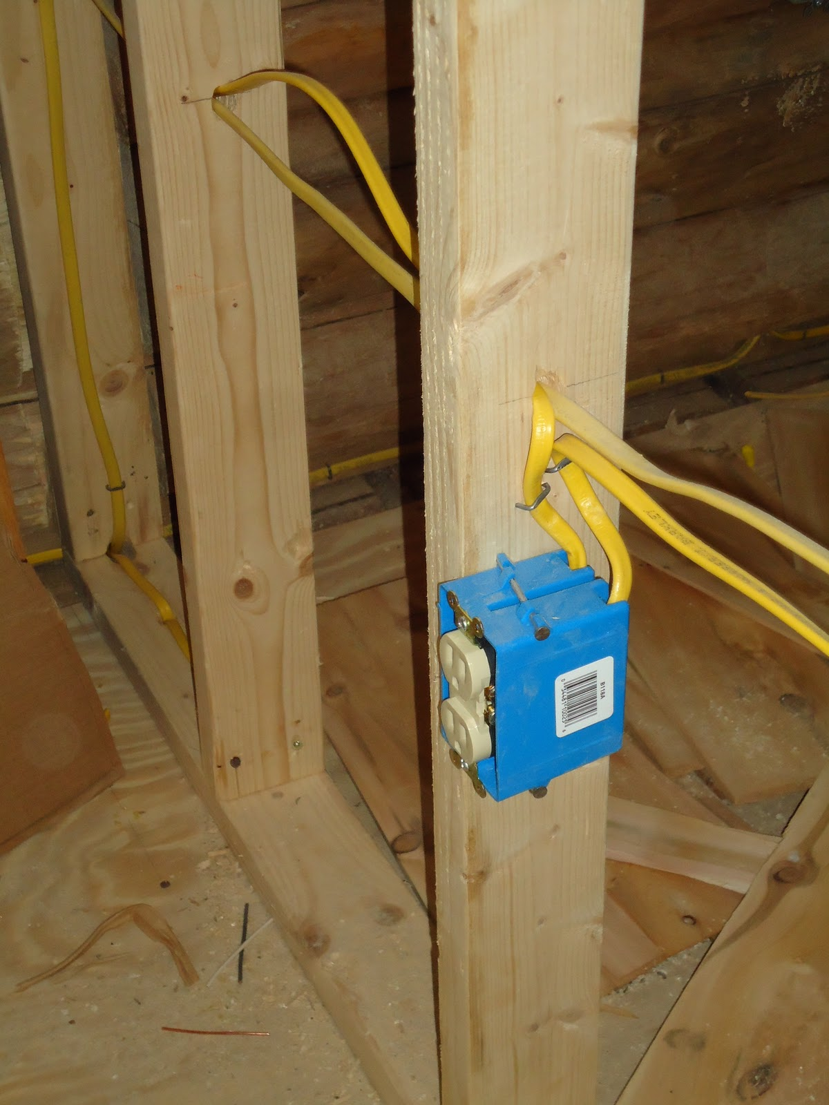 Look at all this electrical wiring up at the log house!