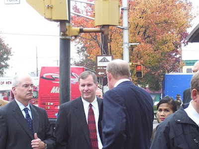 Joe Loftus, Greg Ballard, and Bob Grand stand in line to see George W. Bush in November of 2007.