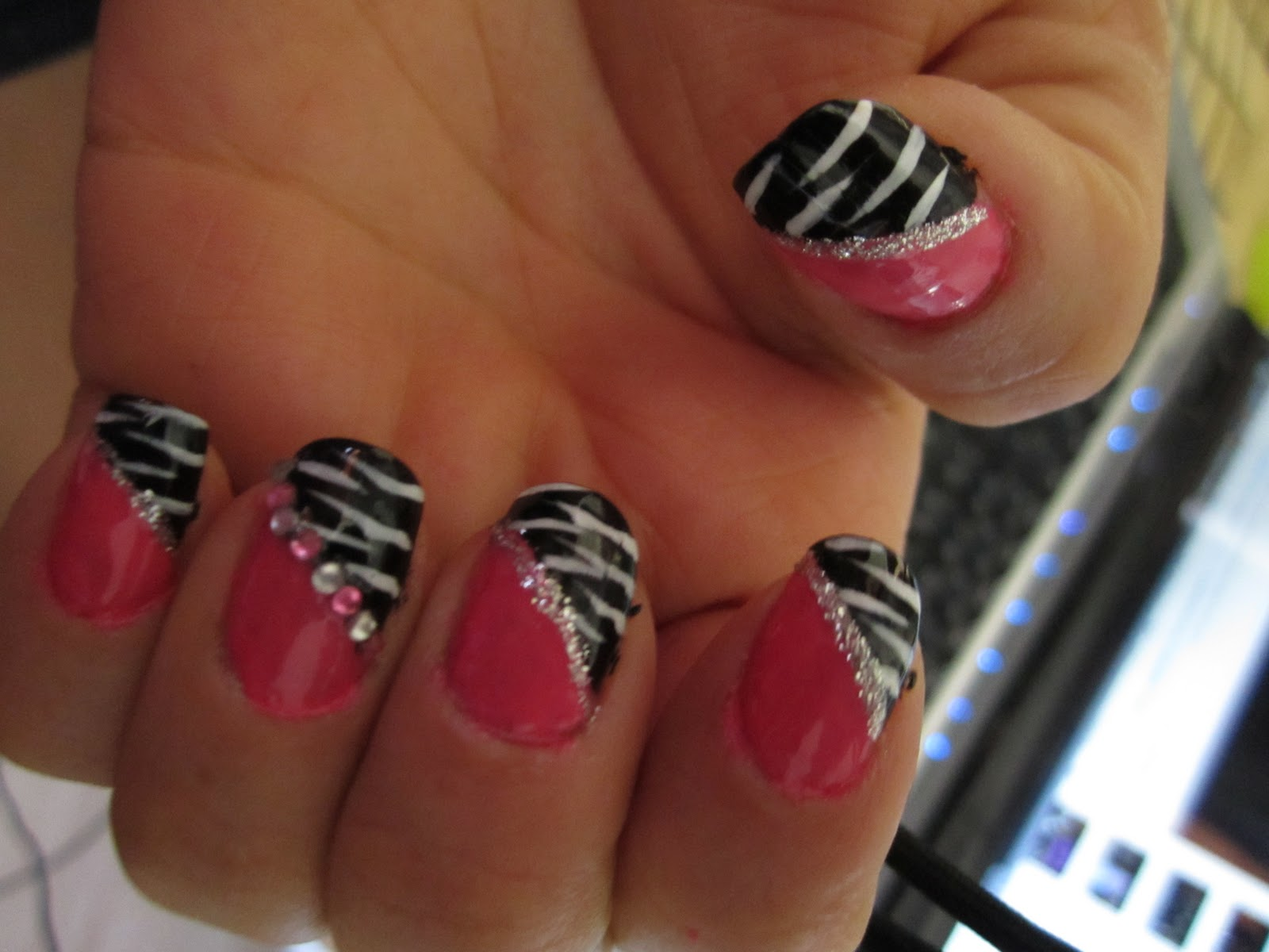 Pink and black zebra nail design blue rhinestones nail design