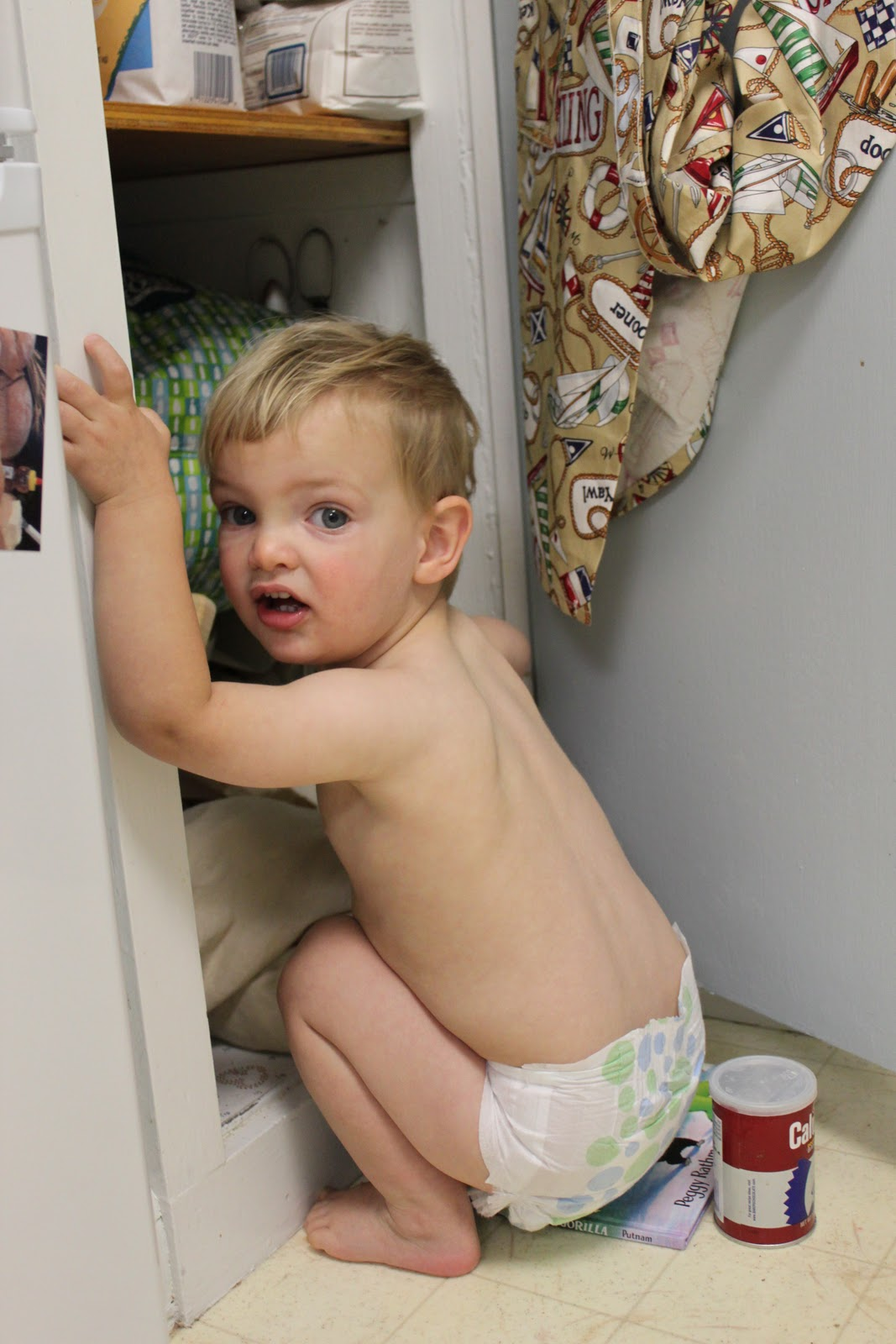 how I keep my child entertained. I let him dig in cupboards half naked ...