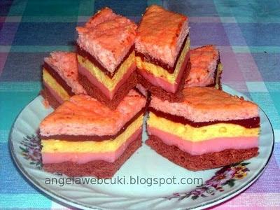 Szivárvány szelet, kevert tésztás sütemény, csokoládé vanília és puncs pudingos tésztával, puncs illetve vanília pudingos töltelékkel.