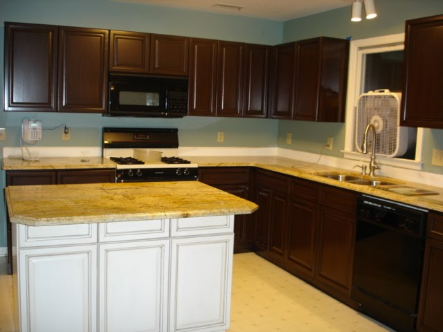 Oak cabinets painted brown with glaze (grain effect)  Refinishing