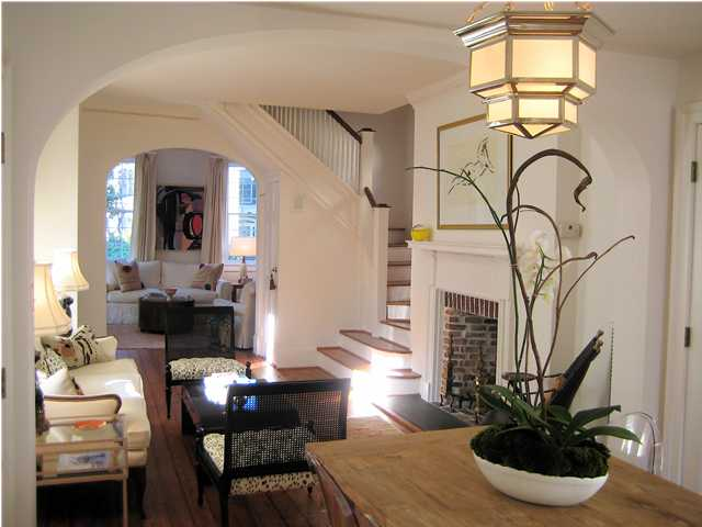 This Home Has Some Very Stylish Features   Love The Animal Print On The  Black Cane Chairs And Of Course The Light Fixture.