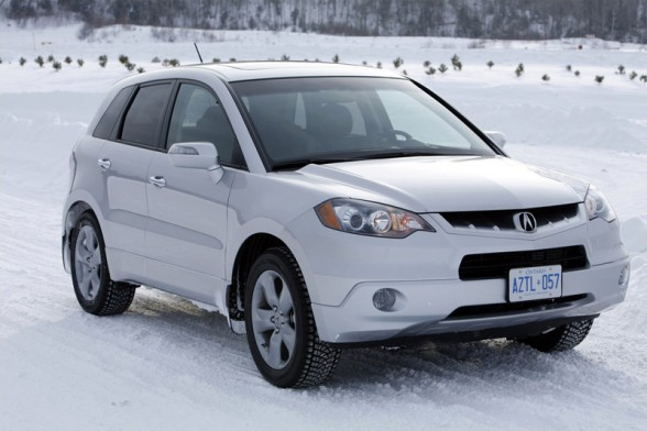 Contestant 1: Used 2009 Acura RDX White exterior, brown interior